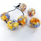 Keramiek kralen rond 20mm oranje met bloemen