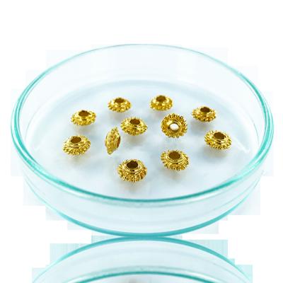Schijfje met kartelrand 7mm goud rond