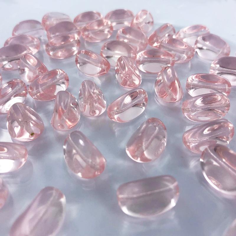 Mooie glaskralen ovaal met vlakke kanten 17mm roze